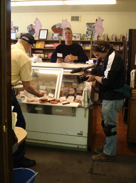 Anthony Bourdain marvels at the assortment of Sausage Shoppe products in the display case